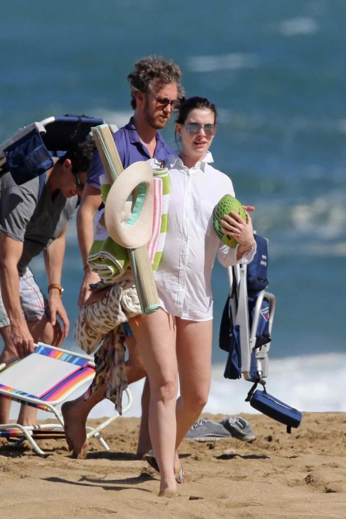 Anne Hathaway in a Red Bikini at the Beach in Hawaii 01/03/2016 -4
