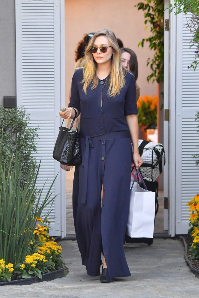 Elizabeth Olsen Arrives to the In Style Gifting Suite in Brentwood, California 08/14/2016-2