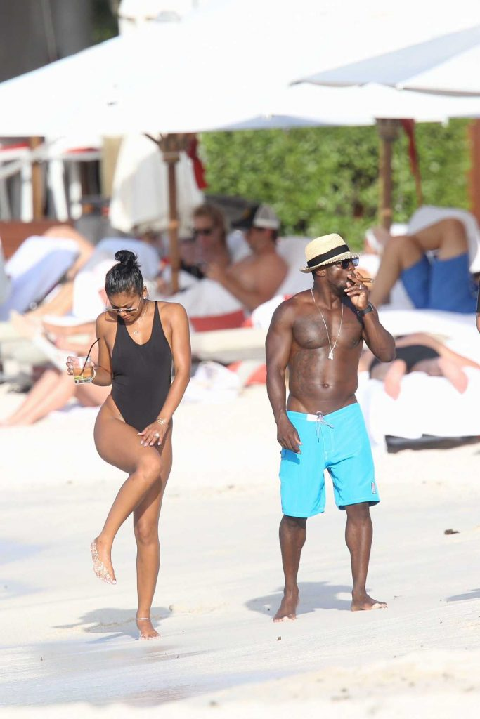 Eniko Parrish in a Black Swimsuit on Honeymoon in St Barts 08/15/2016 ... Kevin