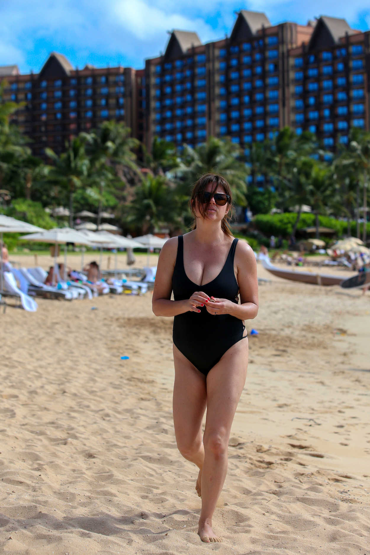 Tiffani Thiessen Wearing a Black Swimsuit at the Beach in ... Victoria Beckham For Target