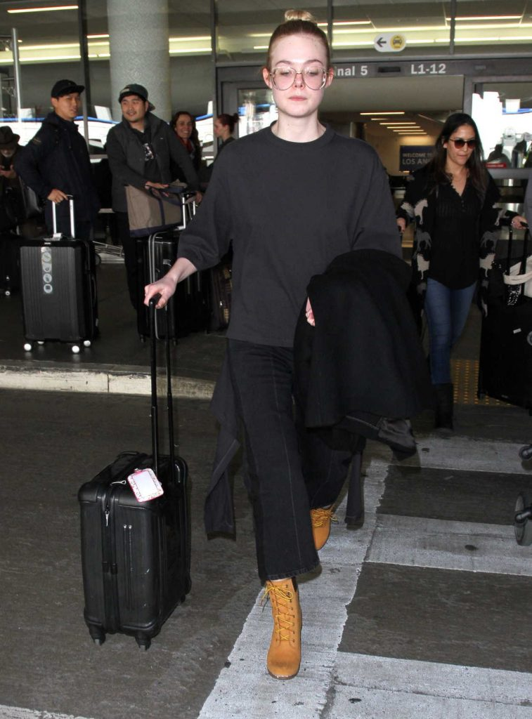 Elle Fanning Arrives at LAX Airport in Los Angeles 01/26/2017-1