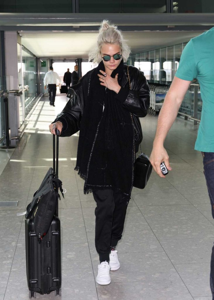 Cara Delevingne Arrives at Heathrow Airport in London 03/26/2017-1