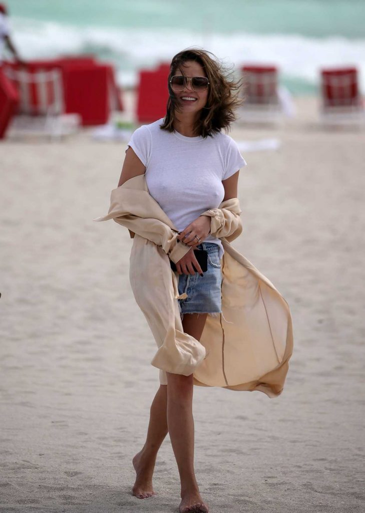 Chrissy Teigen Wears a White T-Shirt at the Beach in Miami 03/04/2017-4