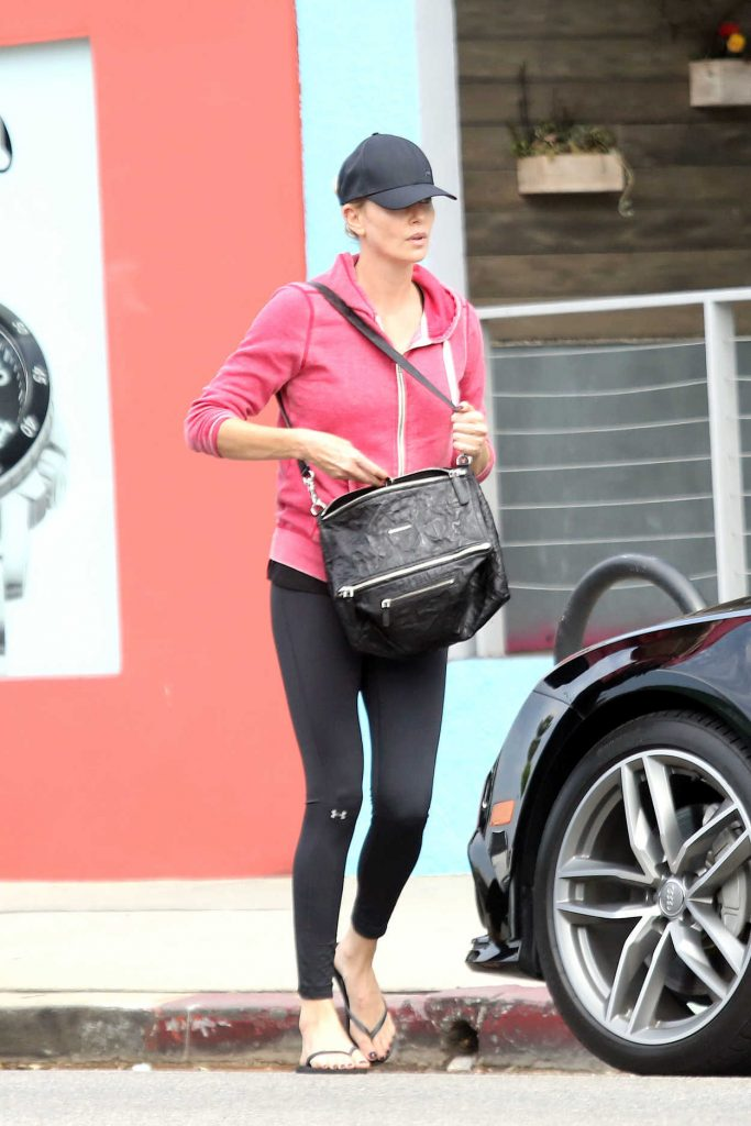 Charlize Theron Wears a Black Under Armour Leggings Out in Los Angeles 07/25/2017-1
