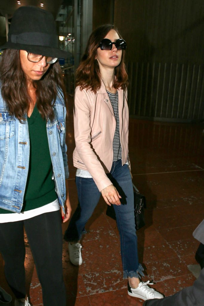 Lily Collins Arrives at CDG Airport in Paris 07/02/2017-3