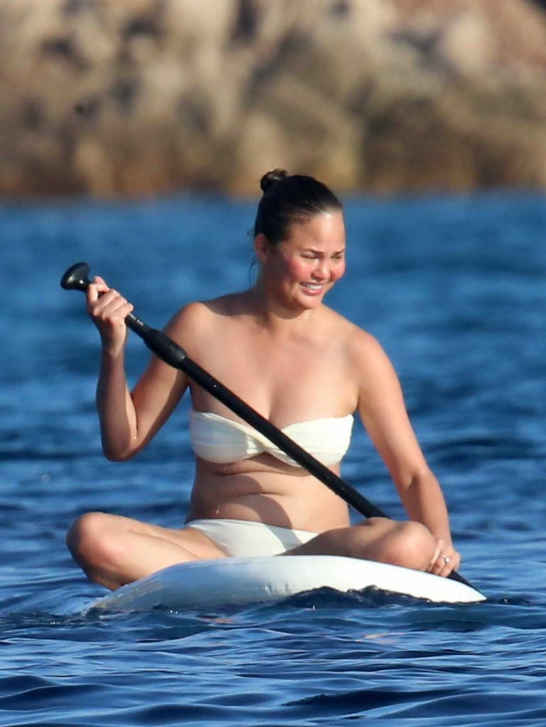 Chrissy Teigen in Bikini on a Yacht in Sardinia 08/30/2017-4