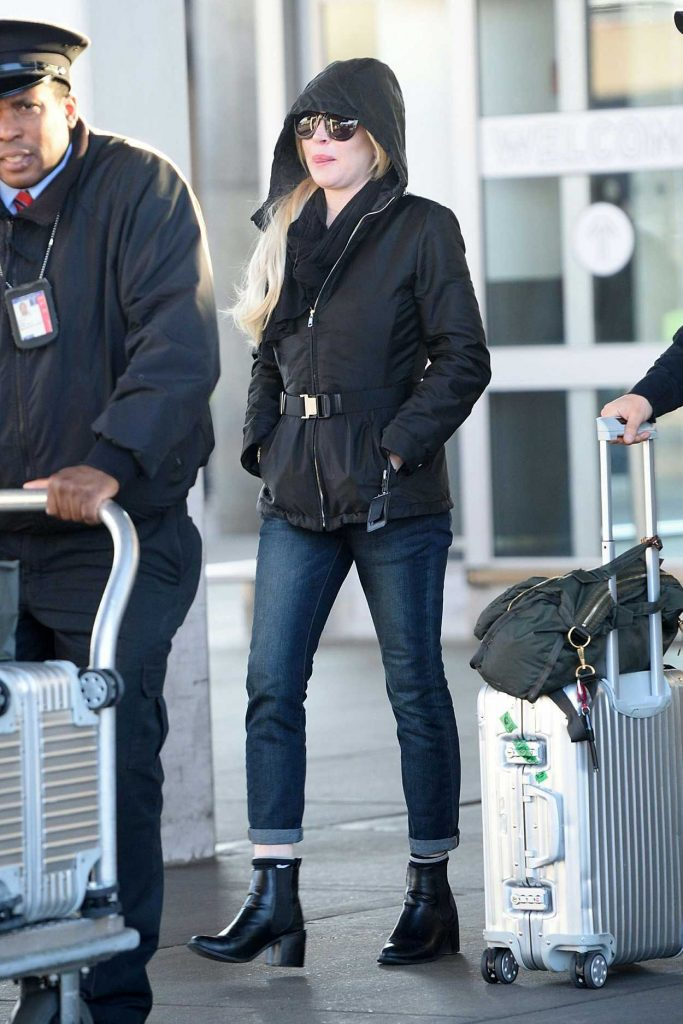 Lindsay Lohan Arrives to JFK Airport in New York City 12/04/2017-4
