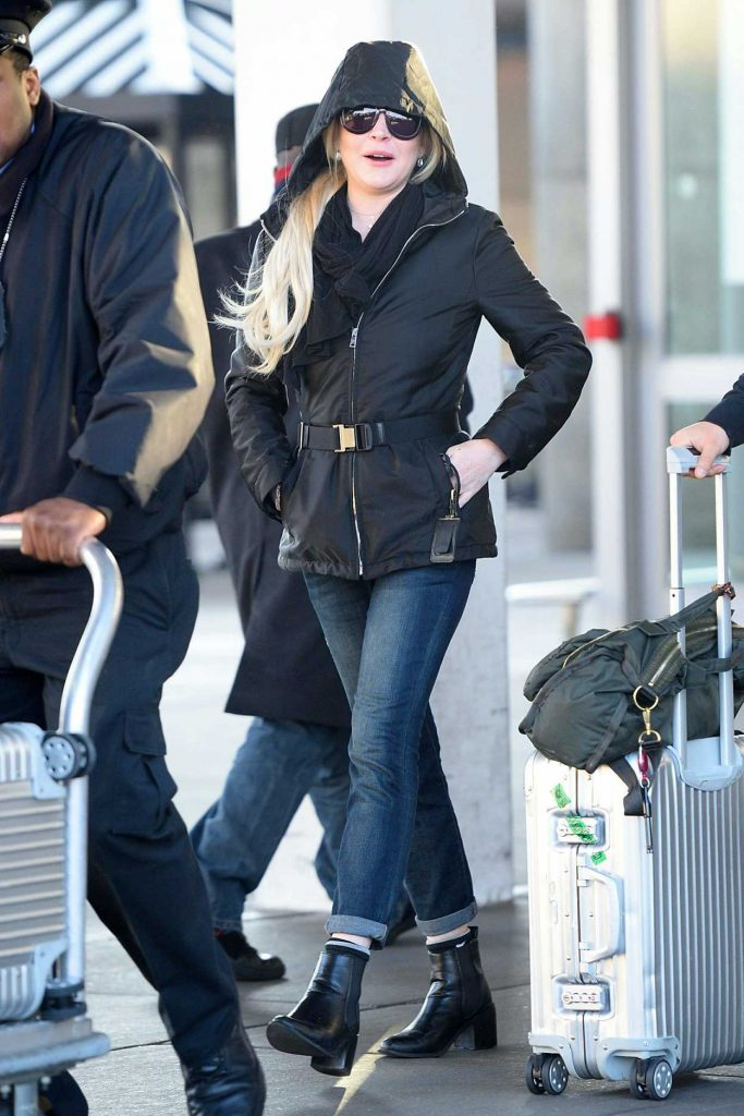 Lindsay Lohan Arrives to JFK Airport in New York City 12/04/2017-5