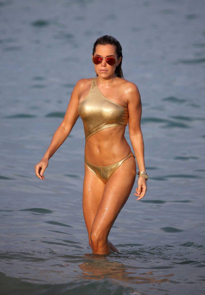 Sylvie Meis Wears a Gold Bikini at the Beach in Miami 01/01/2018-2