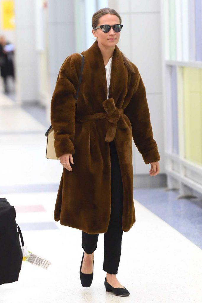 Alicia Vikander Arrives at JFK Airport in NYC 02/20/2018-1