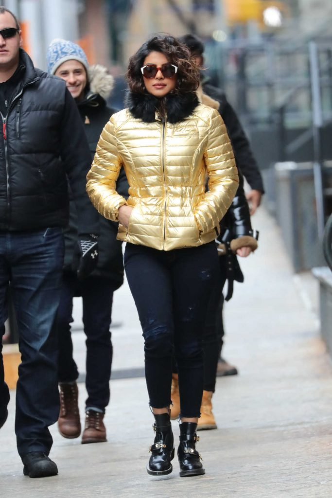 Priyanka Chopra Wears a Gold Puffy Coat with Dark Jeans on the Set of Quantico in NYC 02/04/2018-1