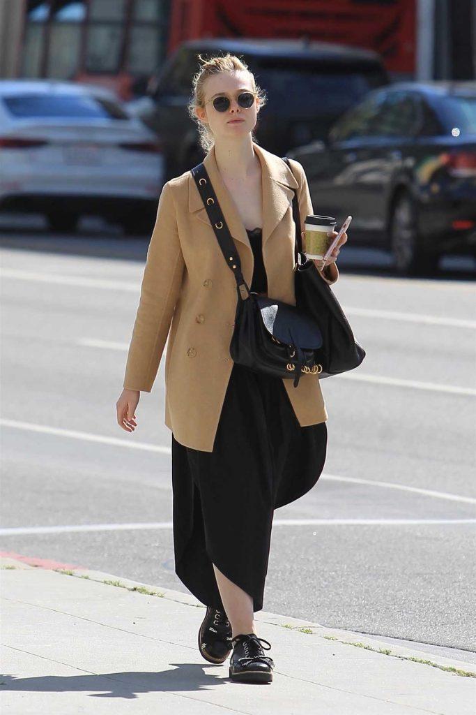 Elle Fanning Wears a Beige Jacket Out in Beverly Hills 03/20/2018-2