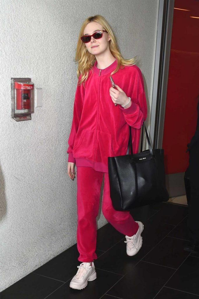 Elle Fanning Wears a Pink Tracksuit at LAX Airport in LA 03/11/2018-1