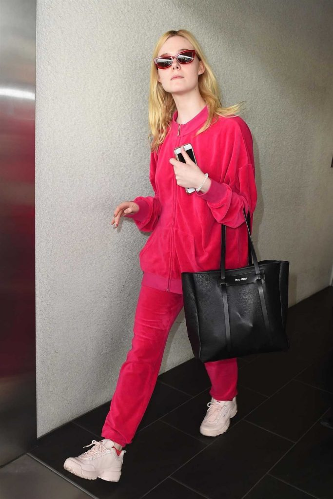 Elle Fanning Wears a Pink Tracksuit at LAX Airport in LA 03/11/2018-2