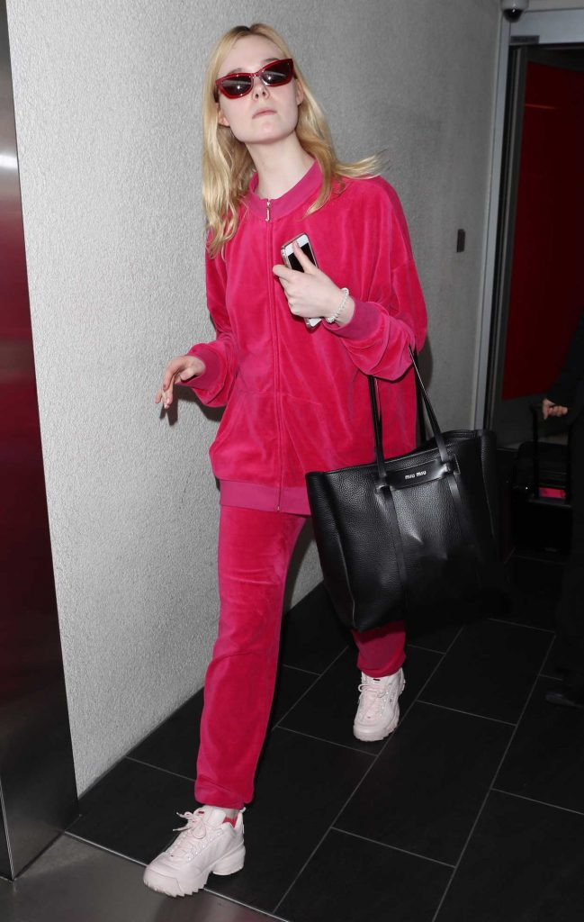 Elle Fanning Wears a Pink Tracksuit at LAX Airport in LA 03/11/2018-4