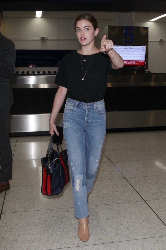 Lucy Hale Wears a Blue Jeans as She Arrives at LAX Airport in LA 04/19/2018-2