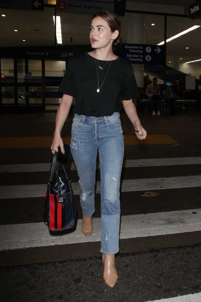 Lucy Hale Wears a Blue Jeans as She Arrives at LAX Airport in LA 04/19/2018-3