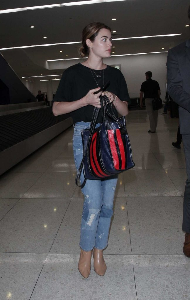 Lucy Hale Wears a Blue Jeans as She Arrives at LAX Airport in LA 04/19/2018-4