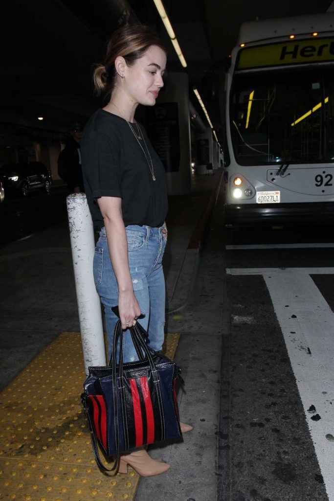 Lucy Hale Wears a Blue Jeans as She Arrives at LAX Airport in LA 04/19/2018-5