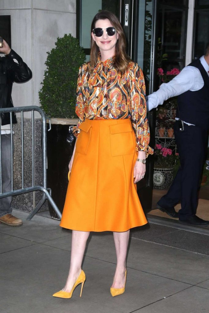 Anne Hathaway Leaves Her Hotel in a Bright Orange Skirt in New York 05/24/2018-1