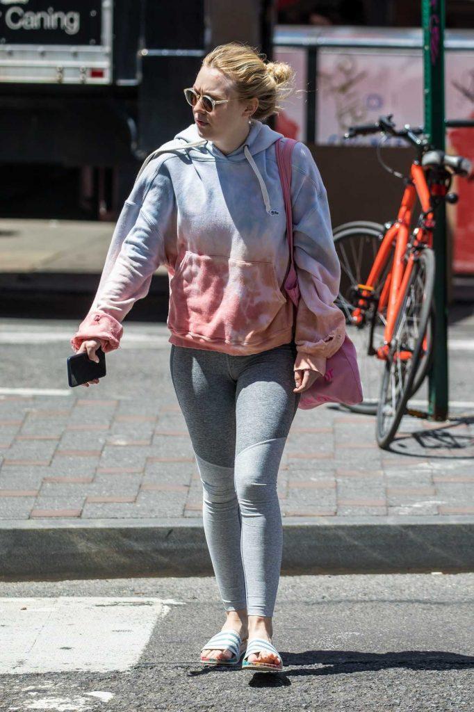 Dakota Fanning Leaves the Gym in New York's Soho District 05/15/2018-4