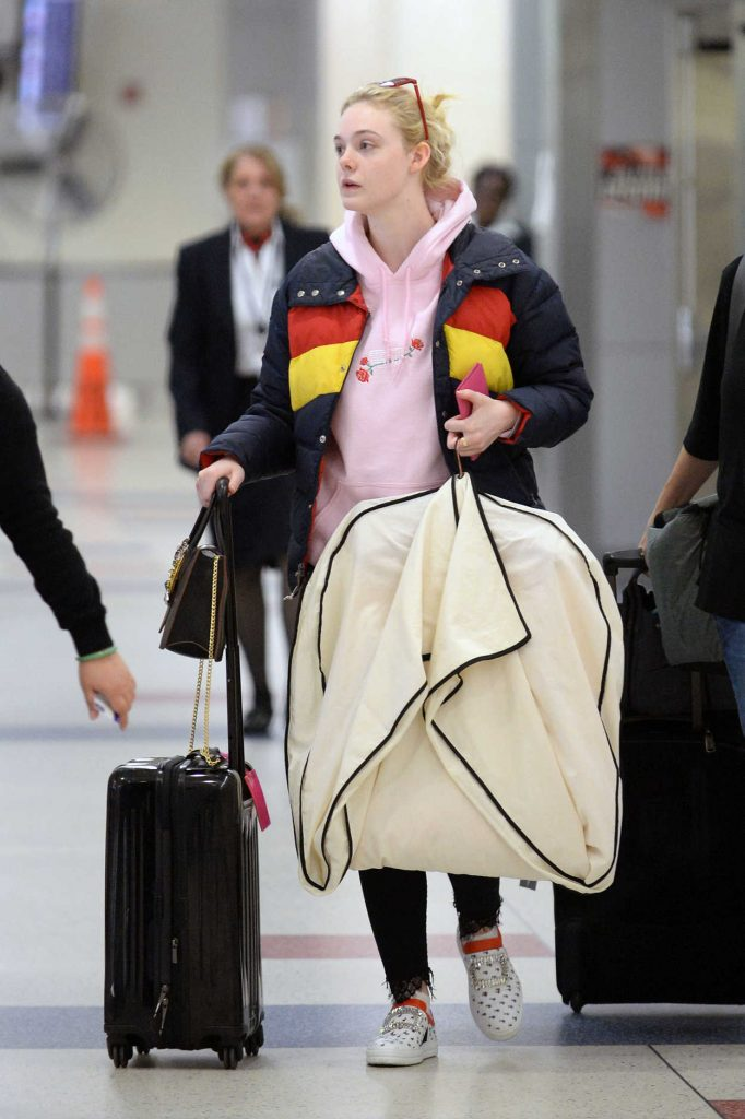 Elle Fanning Carries Her Own Luggage at JFK Airport in New York City 05/03/2018-1