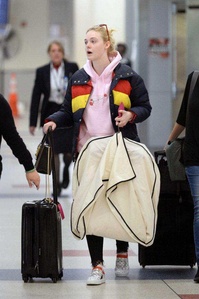 Elle Fanning Carries Her Own Luggage at JFK Airport in New York City 05/03/2018-2