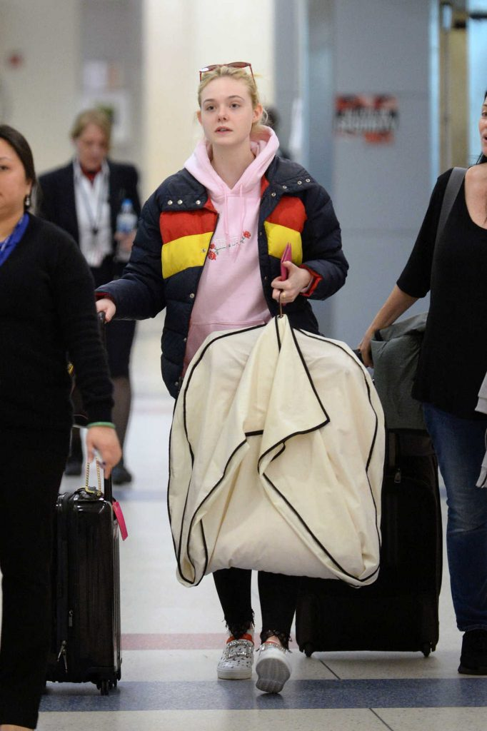 Elle Fanning Carries Her Own Luggage at JFK Airport in New York City 05/03/2018-3