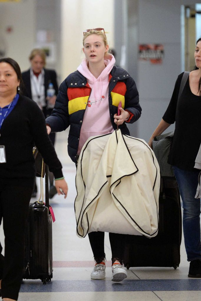 Elle Fanning Carries Her Own Luggage at JFK Airport in New York City 05/03/2018-4