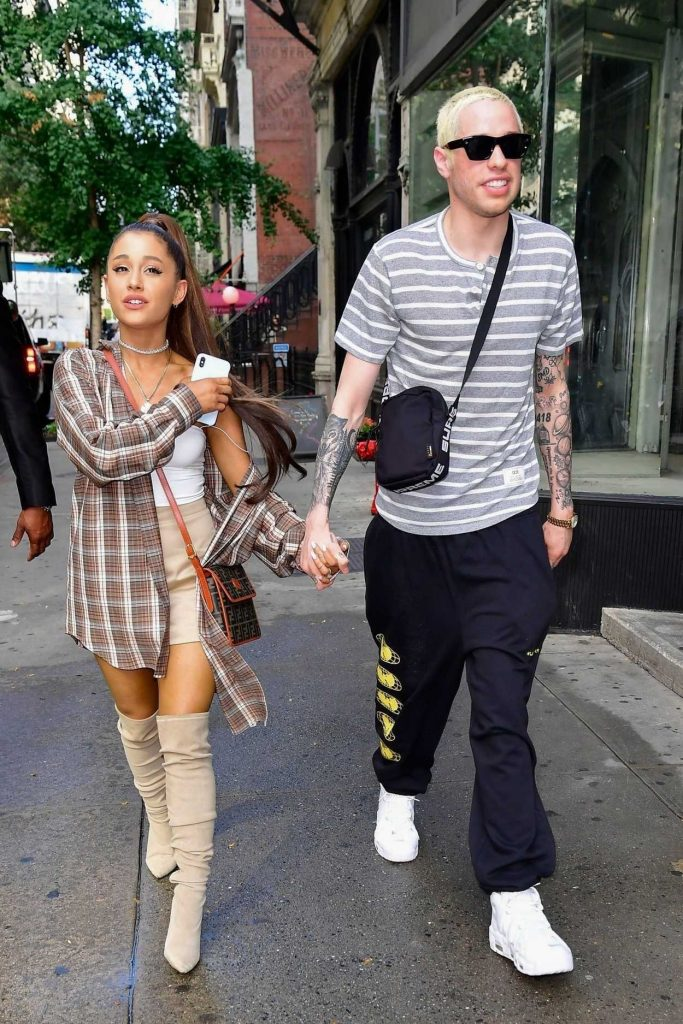 Ariana Grande in a Large Checkered Shirt Goes Shopping at Barney's New York Out with and Pete Davidson in New York City 07/16/2018-2