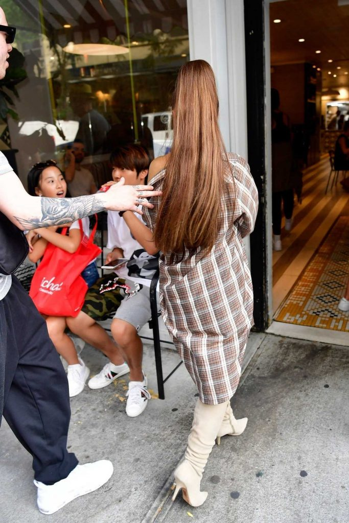 Ariana Grande in a Large Checkered Shirt Goes Shopping at Barney's New York Out with and Pete Davidson in New York City 07/16/2018-5