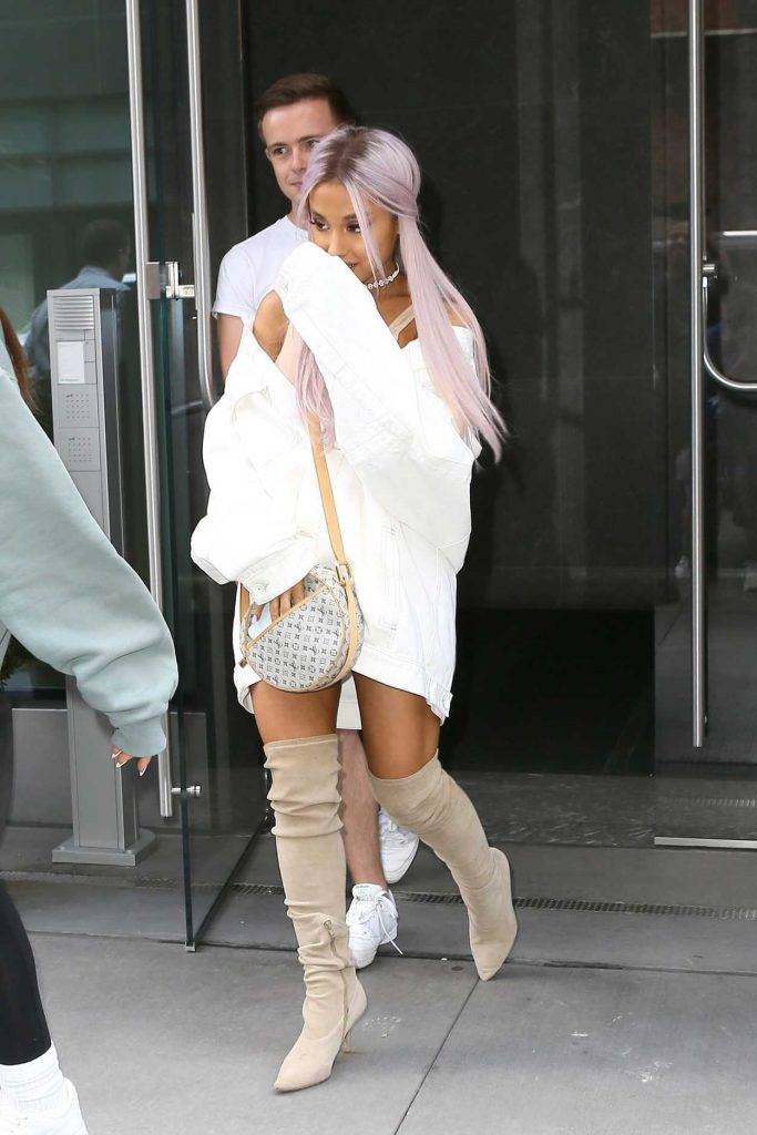 Ariana Grande Wears a Large White Jacket Out in New York City 07/18/2018-1