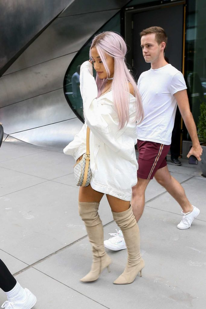 Ariana Grande Wears a Large White Jacket Out in New York City 07/18/2018-3