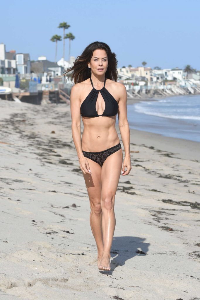 Brooke Burke in a Black Bikini