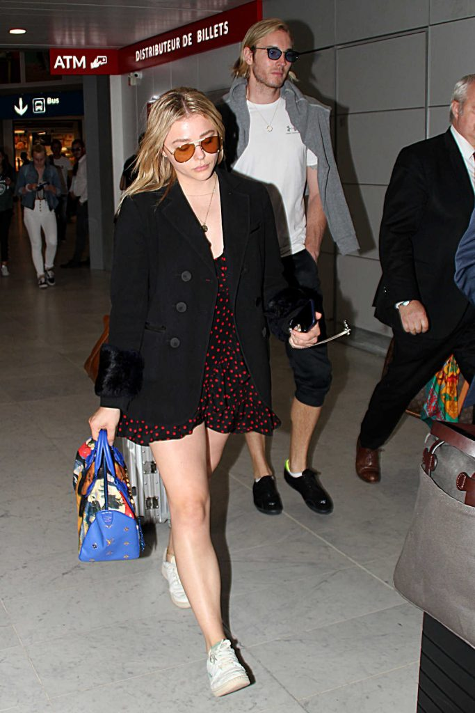 Chloe Moretz Arrives with Her Brother Trevor at Charles de Gaulle Airport in Paris 06/30/2018-1