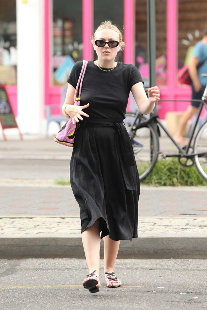 Dakota Fanning in a Black T-Shirt