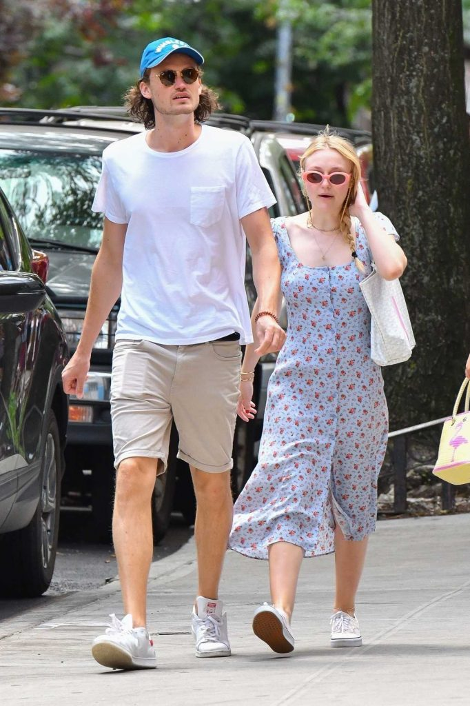 Dakota Fanning in a Summer Long Dress Walks Out with her boyfriend Henry Fre in Soho, NY 07/21/2018-4