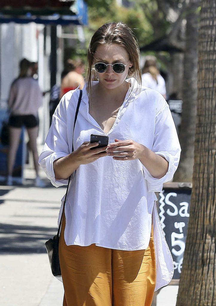 Elizabeth Olsen in a Goldenrod Wide Pants