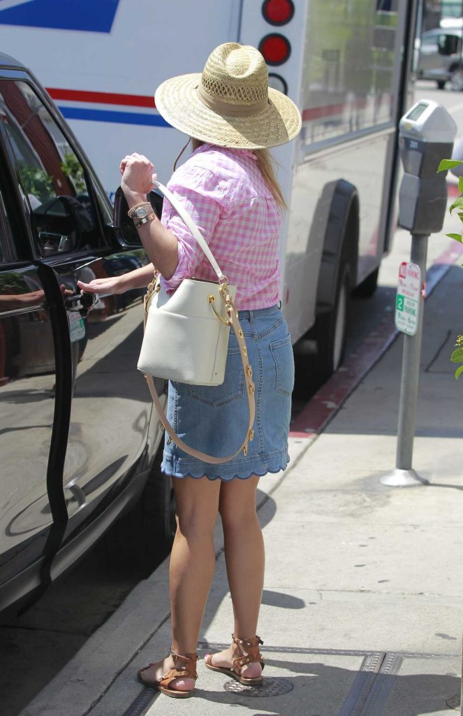 Reese Witherspoon Wears a Short Denim Skirt Out in Brentwood 07/19/2018-4
