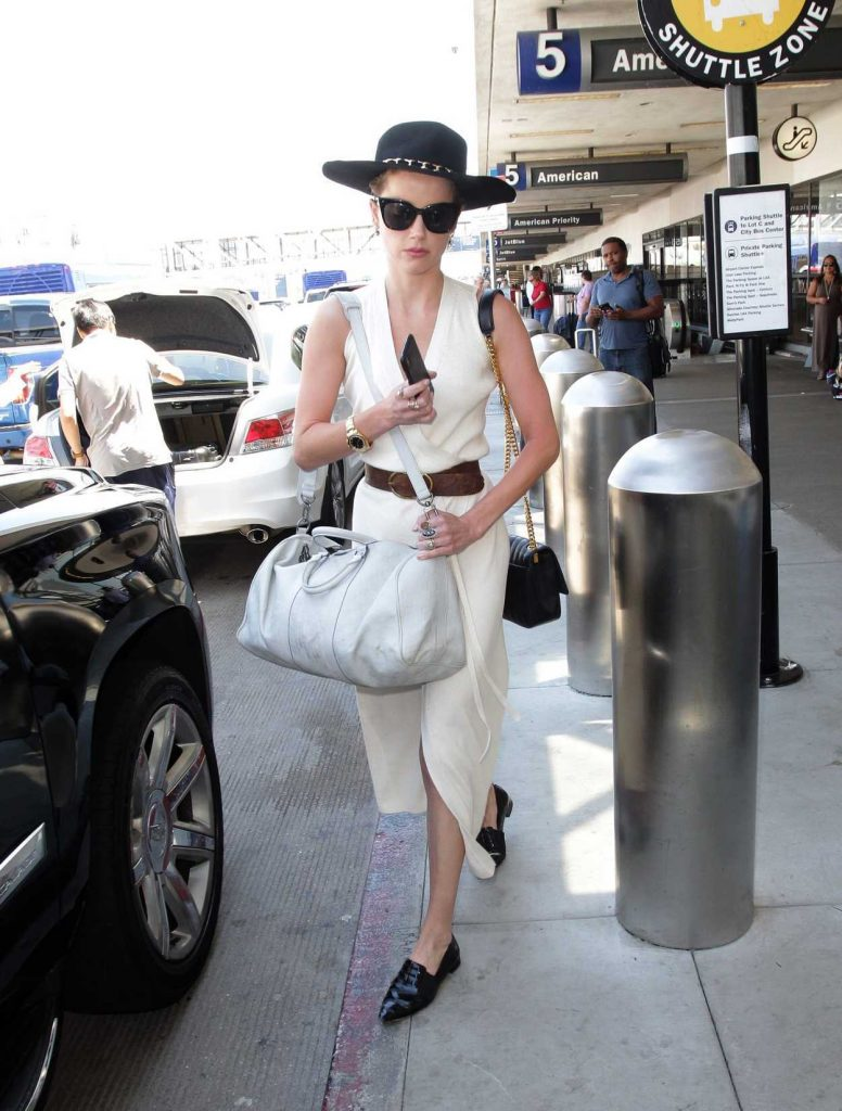 Amber Heard in a Black Stylish Hat