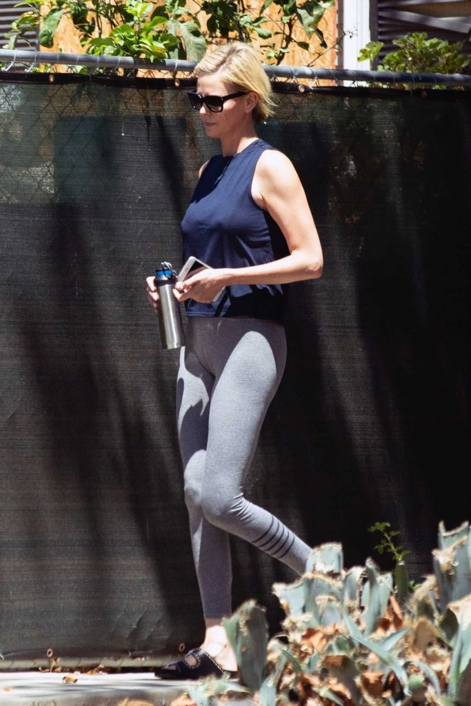 Charlize Theron in a Gray Leggings