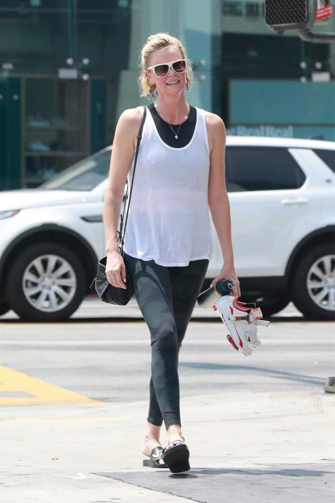 Charlize Theron in a Military Leggings
