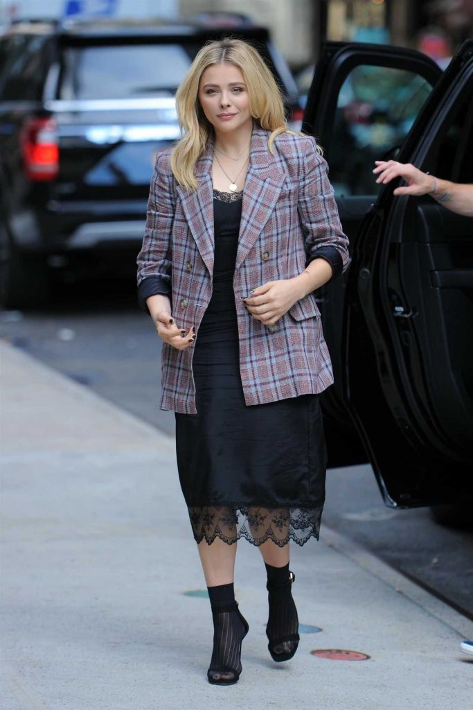 Chloe Moretz in a Plaid Jacket
