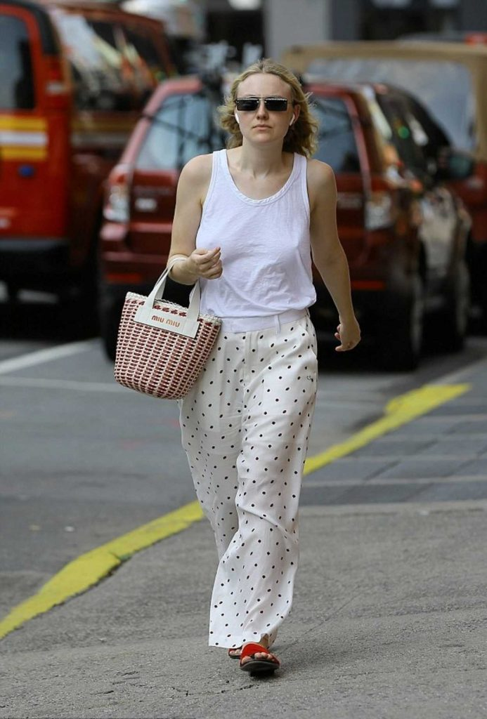 Dakota Fanning in a White Tank Top