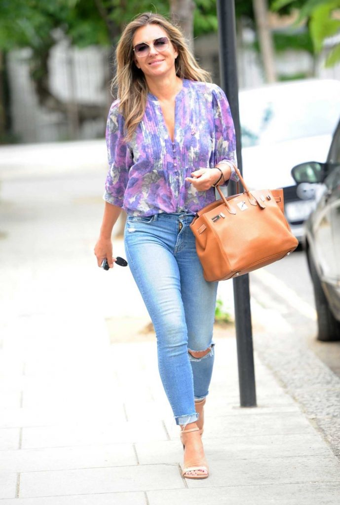 Elizabeth Hurley in a Blue Ripped Jeans