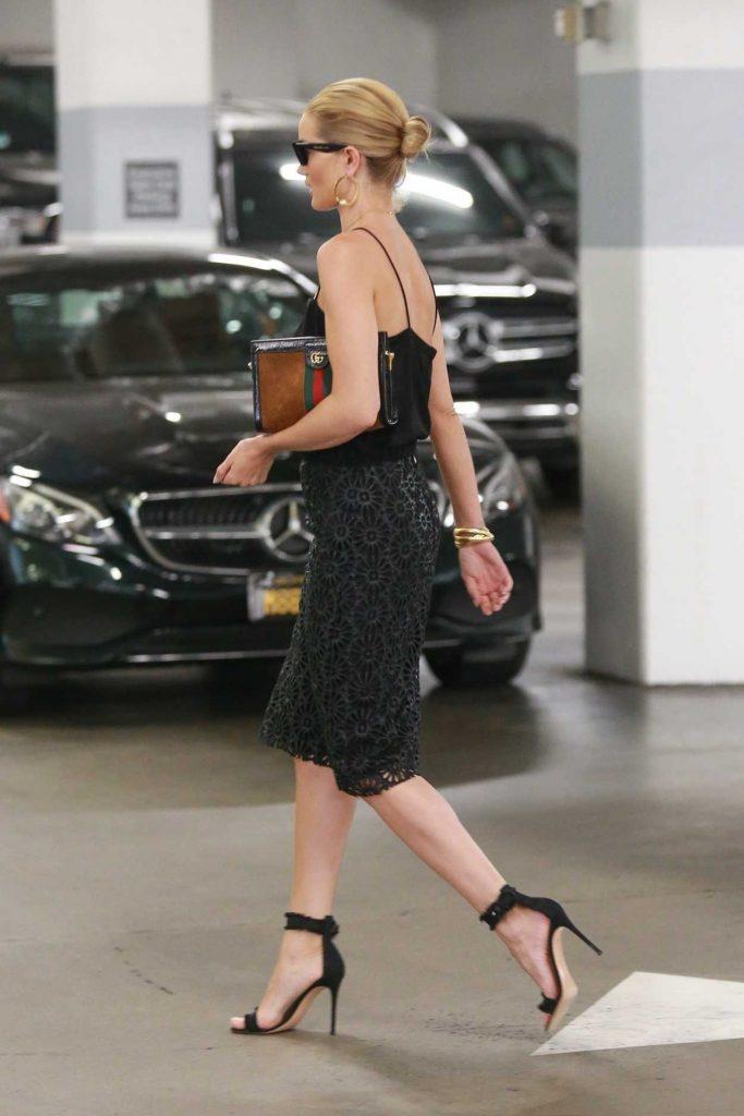 Rosie Huntington-Whiteley in a Black Dress