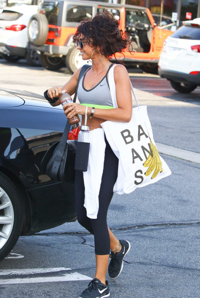 Sarah Hyland in a Gray Sports Bra