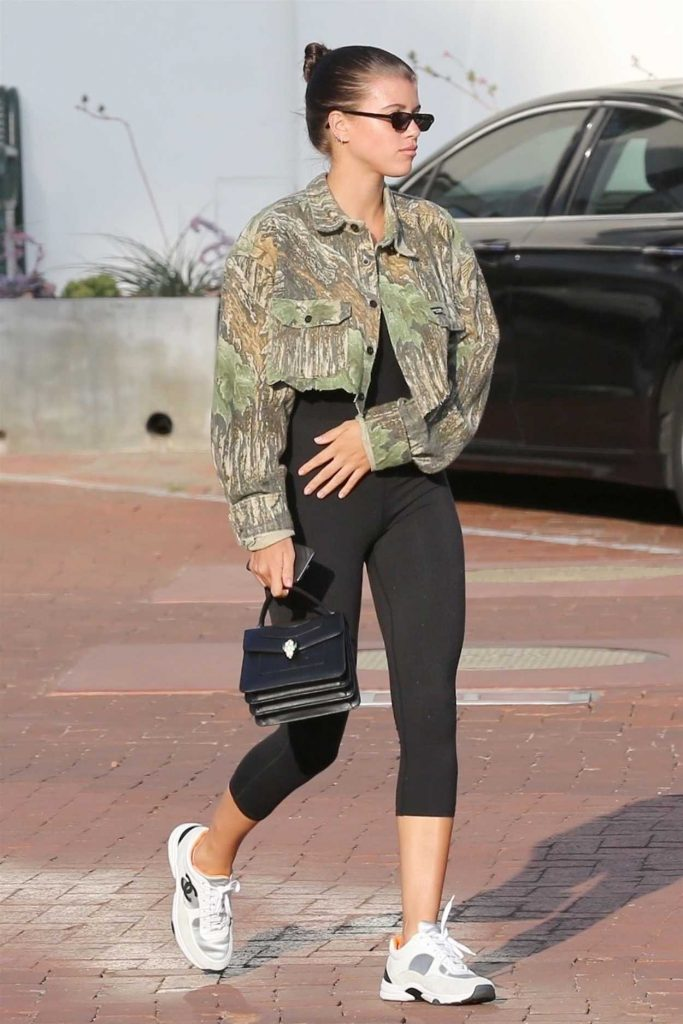 Sofia Richie a White Under Armour Sneakers