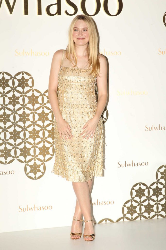 Dakota Fanning in a Gold Dress