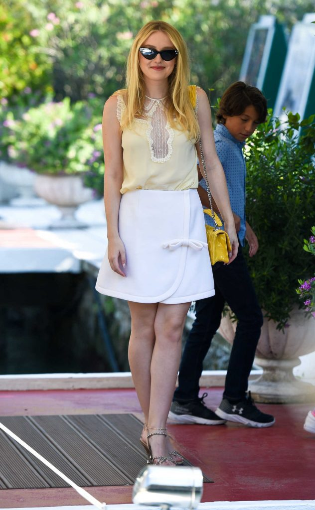 Dakota Fanning in a Yellow Embroidered Blouse